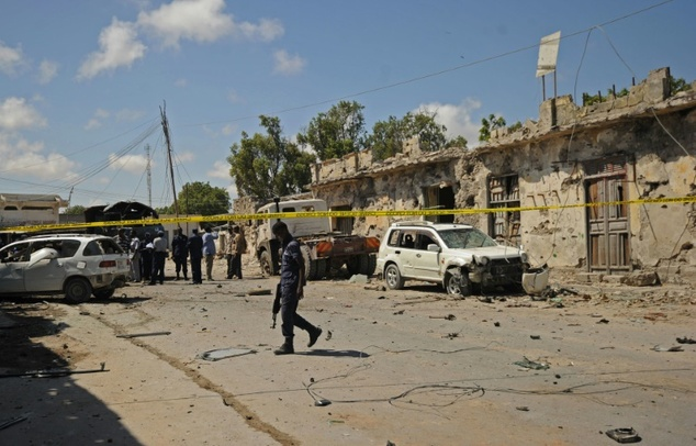Somali soldiers patrol near the scene of explosion outside a restaurant in Mogadishu on April 9, 2016 . Mohamed Abdiwahab (AFP)