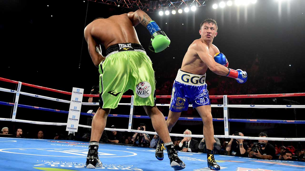 INGLEWOOD, CA - APRIL 23: Gennady Golovkin of Kazakhstan punches Dominic Wade on way to a second round TKO during his unified middleweight title fight at The Forum on April 23, 2016 in Inglewood, California. Harry How/Getty Images/AFP Harry How / GETTY IMAGES NORTH AMERICA / AFP