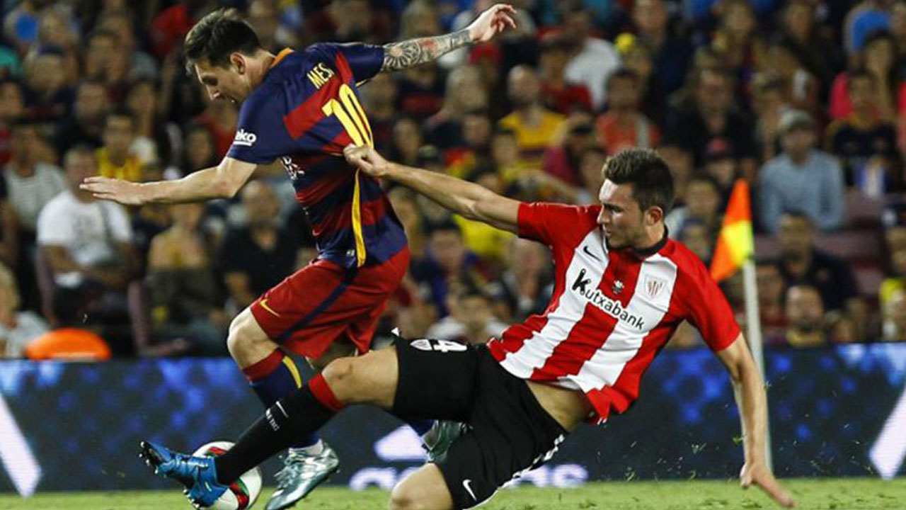 Barcelona's Argentinean forward Lionel Messi (L) vies with Athletic Bilbao's defender Aymeric Laporte (R) during the Spanish Supercup second-leg Photo AFP.