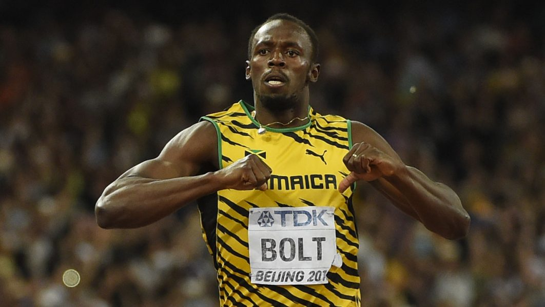 "(FILES) This file photo taken on August 27, 2015 shows Jamaica's Usain Bolt celebrating after winning the final of the men's 200 metres athletics event at the 2015 IAAF World Championships at the ""Bird's Nest"" National Stadium in Beijing on August 27, 2015. / AFP PHOTO / Olivier MORIN"