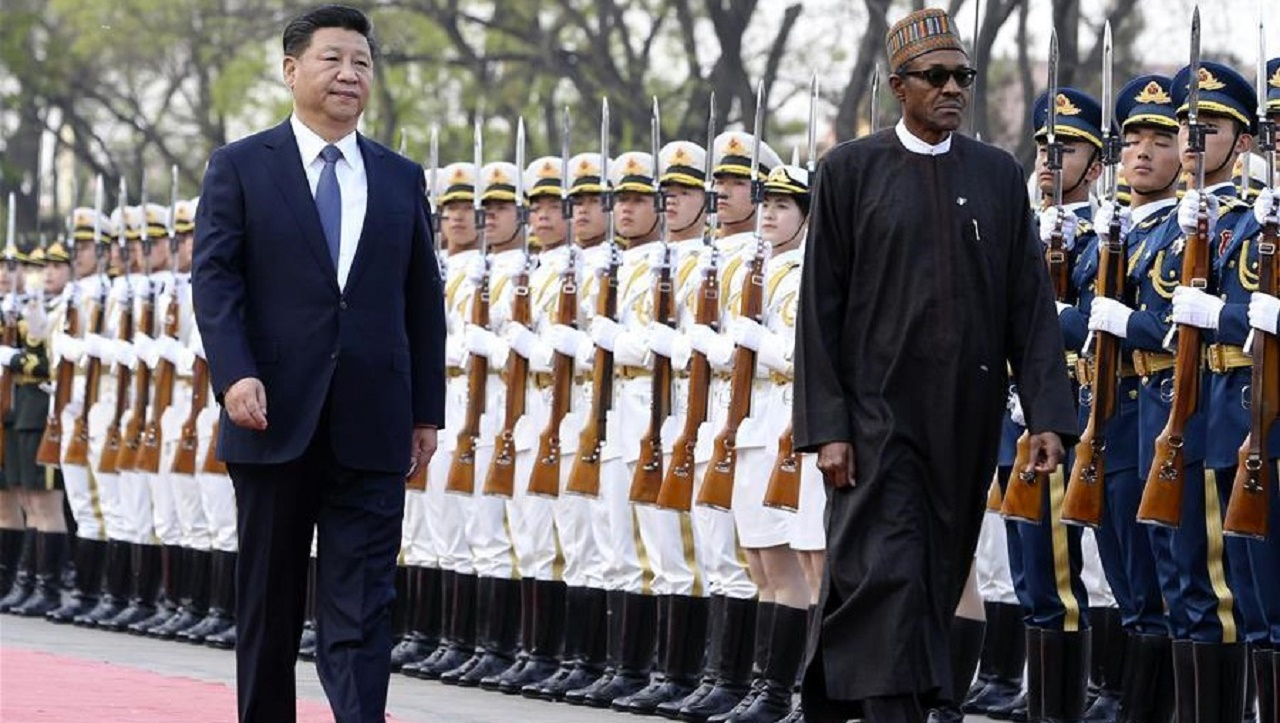 Chinese PresidentXi Jinping(L) holds a welcoming ceremony for Nigerian President Muhammadu Buhari before their talks in Beijing, capital of China.