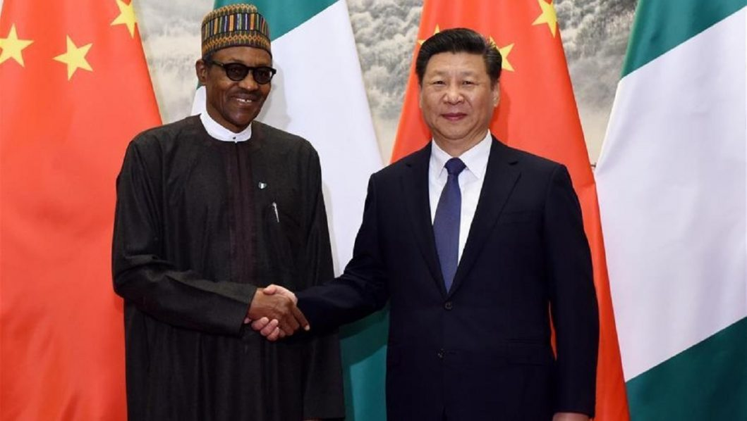 BEIJING, April 12, 2016 (Xinhua) -- Chinese PresidentXi Jinping(R) holds talks with Nigerian President Muhammadu Buhari in Beijing, capital of China, April 12, 2016. (Xinhua/Rao Aimin)