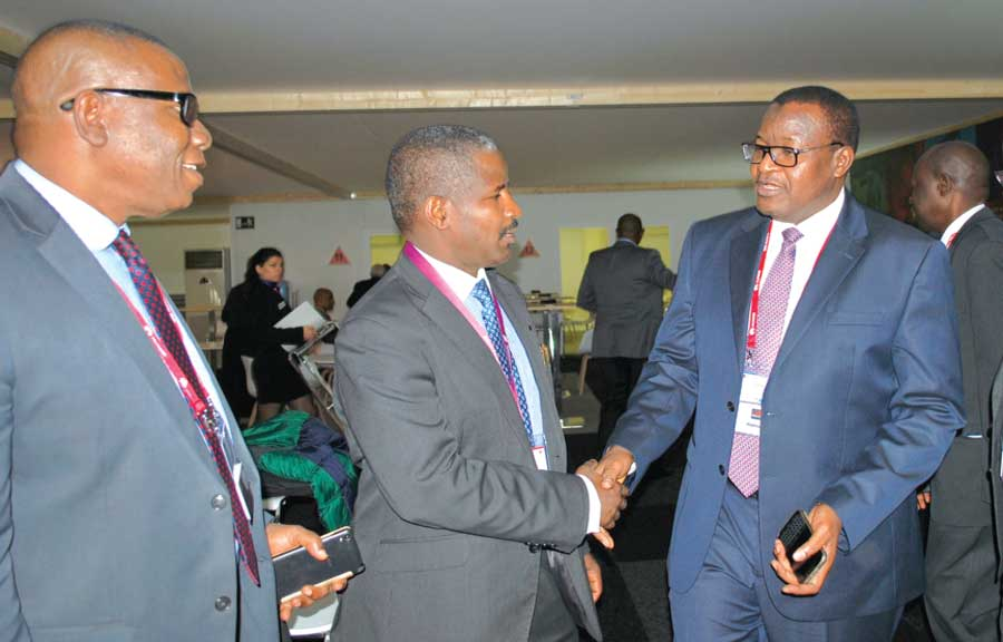Executive Vice Chairman of Nigerian Communications Commission (NCC), Prof. Umar Danbatta (right) in a handshake with Chairman of the Commonwealth International Telecommunications Union Group, Dr. Bashir Gwandu at the Mobile World Congress which held in Spain. With them is Dr. Henry Nkemadu, a Deputy Director at the Commission.