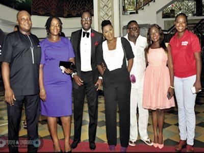 Elliot (second left), Uche Jombo, Lancelot Imasuen, other well-wishers at the premiere