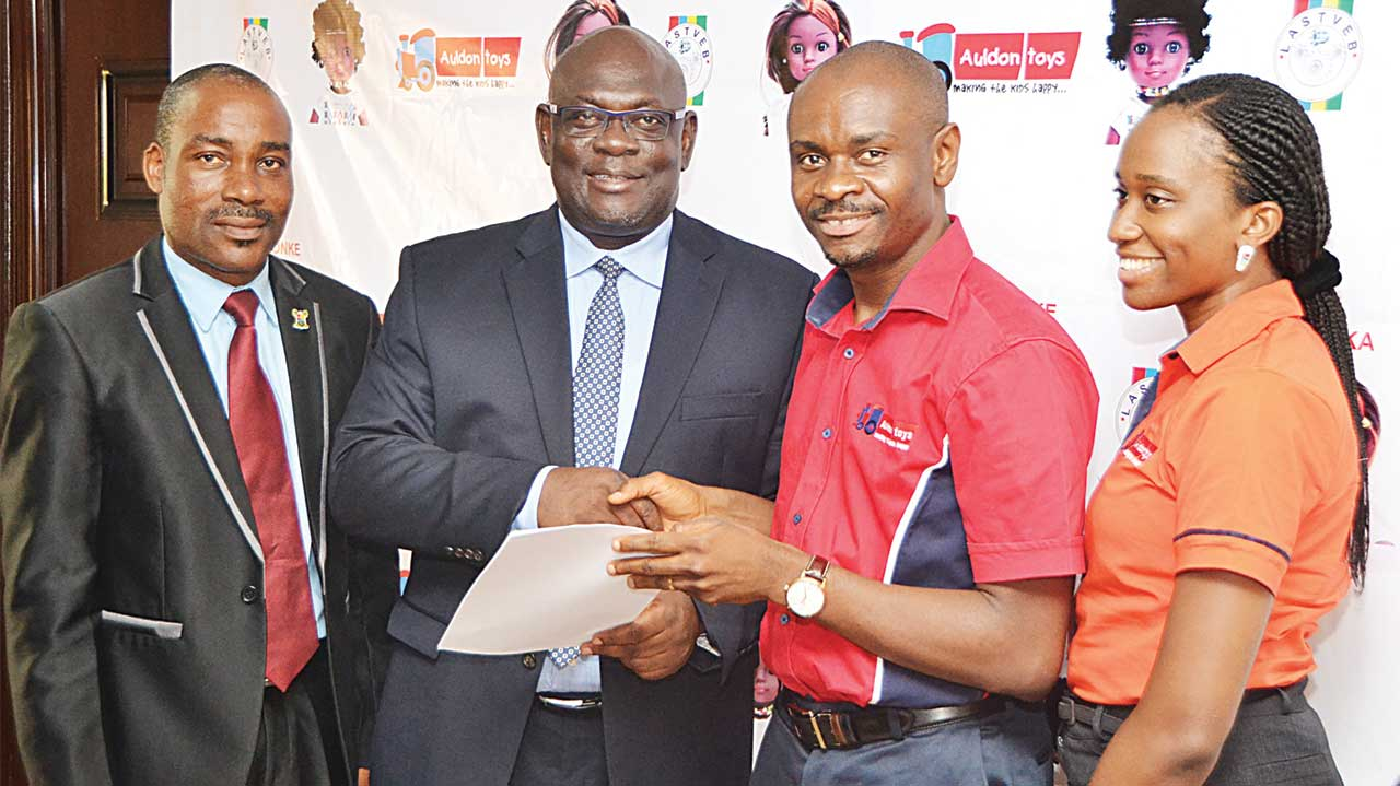 Director, Modern Apprenticeship Training Programme, Lagos State Technical  and Vocational Education Board (LASTVEB), Awoyera Oluremi (left); Executive Secretary, LASTVEB, Olawumi Gasper;  Chief Executive Officer, Auldon Toys, Paul Orajiaka; and General Manager, Auldon Ltd, Ezenwanne Chiamaka, at the signing of MoU between LASTVEB and Auldon Ltd for the clothing of the Unity Dolls in Lagos.
