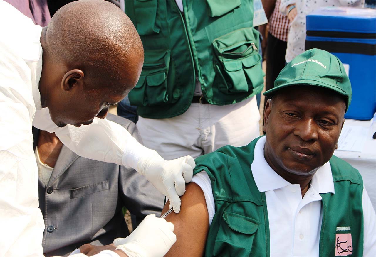A man gets vaccinated against the Ebola virus