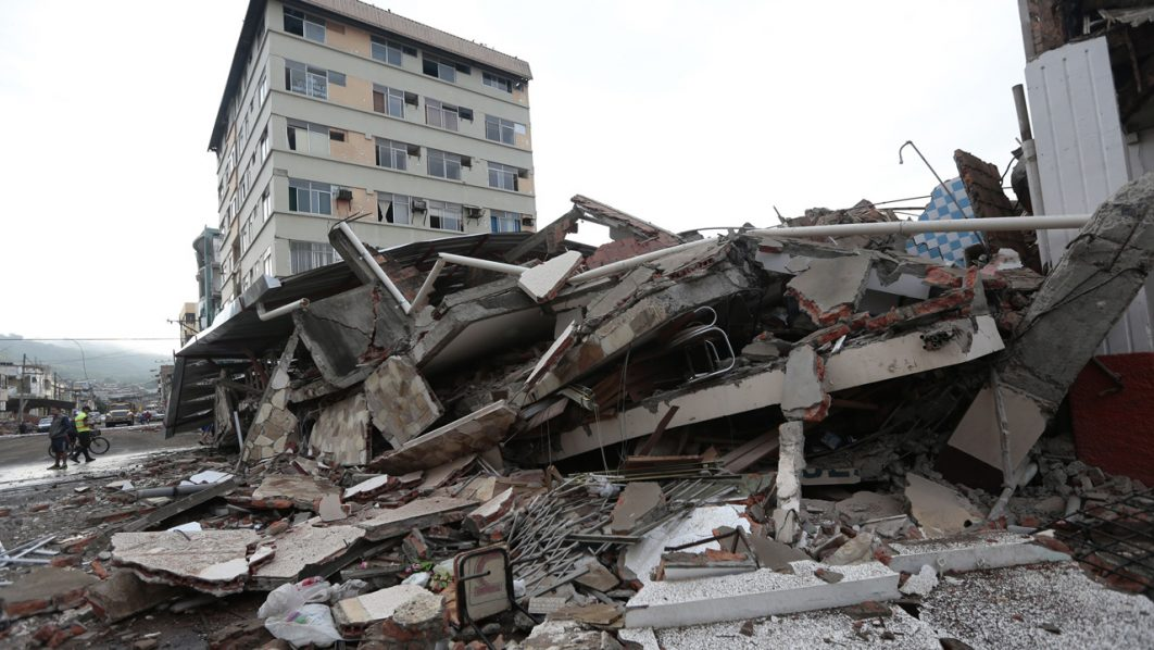 View of rubble after a 7.8-magnitude quake in Portoviejo, Ecuador on April 17, 2016. At least 235 people were killed when a powerful earthquake struck Ecuador, destroying buildings and a bridge and sending terrified residents scrambling from their homes, authorities said Sunday. / AFP PHOTO / JUAN CEVALLOS