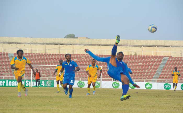 Enyimba captain, Chinedu Udoji, executing a bicycle kick in a recent game against Warri Wolves. The Peoples Elephant have qualified for the semifinals of Abia State FA Cup. PHOTO: LMC.