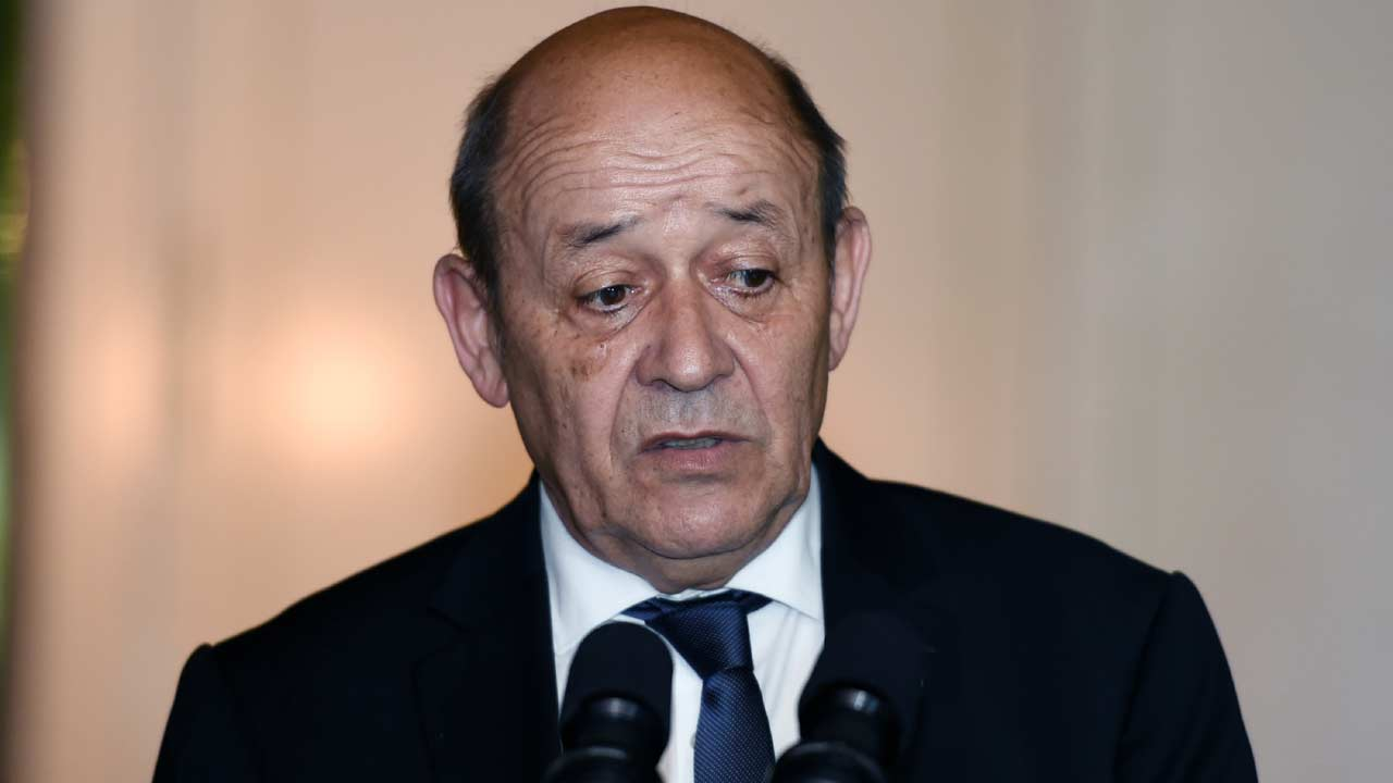 French Defence minister Jean-Yves Le Drian speaks to the journalists after a meeting with the Ivorian president at the presidential palace in Abidjan on April 29, 2016. SIA KAMBOU / AFP