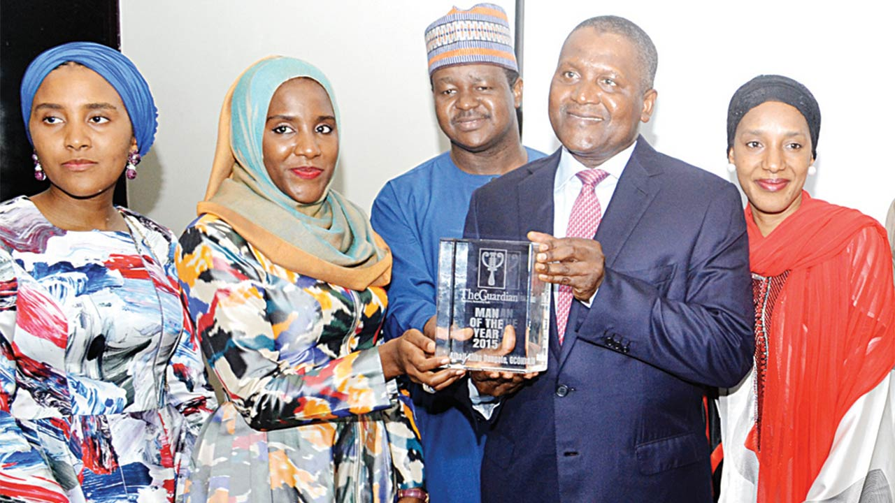 Daughters of Aliko Dangote, Fatimo (left) and Halima; Alhassan Dantata; Dangote; and Mariam, another daughter during the presentation of The Guardian Man of the Year 2015 to the president of the Dangote Group at the weekend PHOTO: GABRIEL IKHAHON