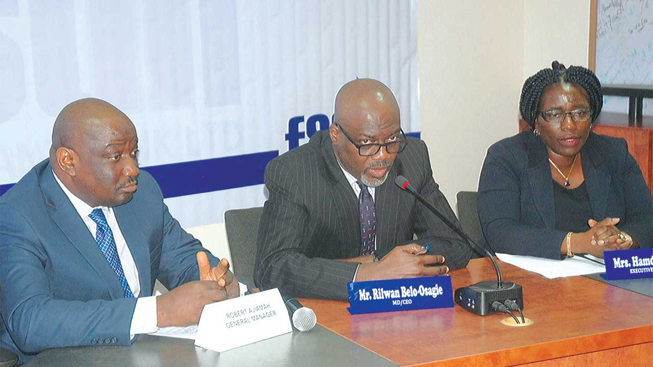 General Manager, FSDH Merchant Bank Limited, Robert Ajiamah(left): Managing Director/Chief Executive Officer, Rilwan Belo-Osagie; Executive Director,  Mrs Hamda Ambah, at the bank's pre-yearly general meeting press briefing in Lagos, yesterday.                 PHOTO: SUNDAY AKINLOLU