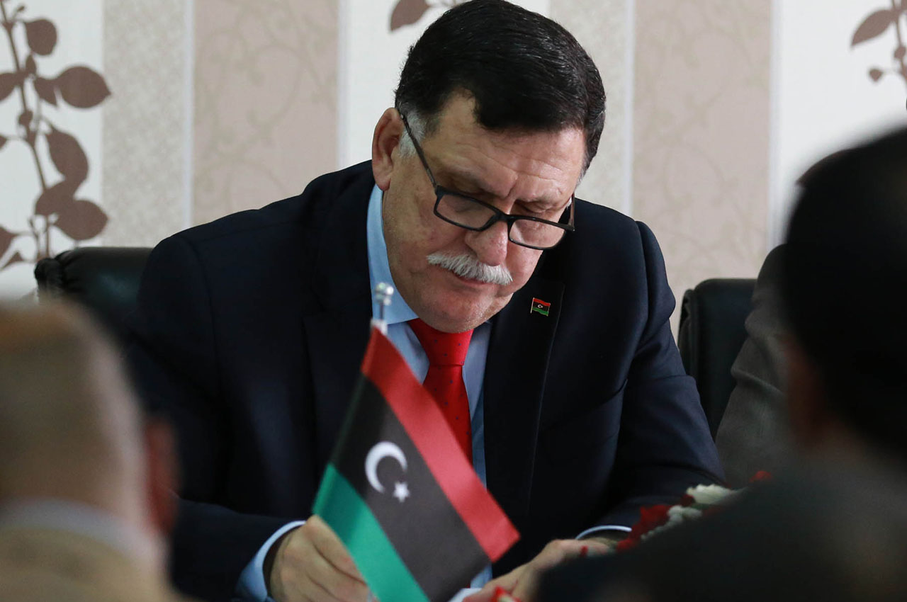 Libya's Prime minister-designate Fayez al-Sarraj chairs a Presidential Council of the Government of National Reconciliation meeting with local mayors inside the naval base in the Libyan capital Tripoli on April 3, 2016.  / AFP / MAHMUD TURKIA