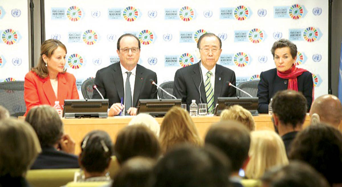French Energy Minister Ségolène Royal, French President François Hollande, U.N. Secretary-General Ban Ki-moon and U.N. climate change secretary Christiana Figures speak to the press after the Paris Agreement signing ceremony. April 22, 2016. PHOTO: Luke Vargas/Talk Media News