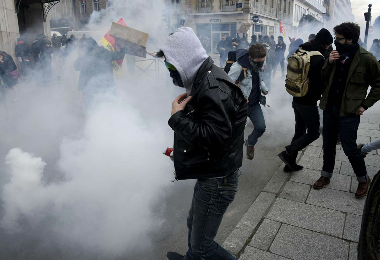Demonstrators clash with anti-riot police during a protest in Paris, against the French government's proposed labour law reforms. PHOTO: www.straitstimes.com