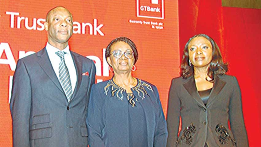 Managing Director, Guaranty Trust Bank Plc, Segun Agbaje (left); Chairman, Mrs. Osaretin Demuren; and, Company Secretary, Mrs. Olutola Omotola, at the bank's 26th  yearly general meeting, in Lagos, on Tuesday.