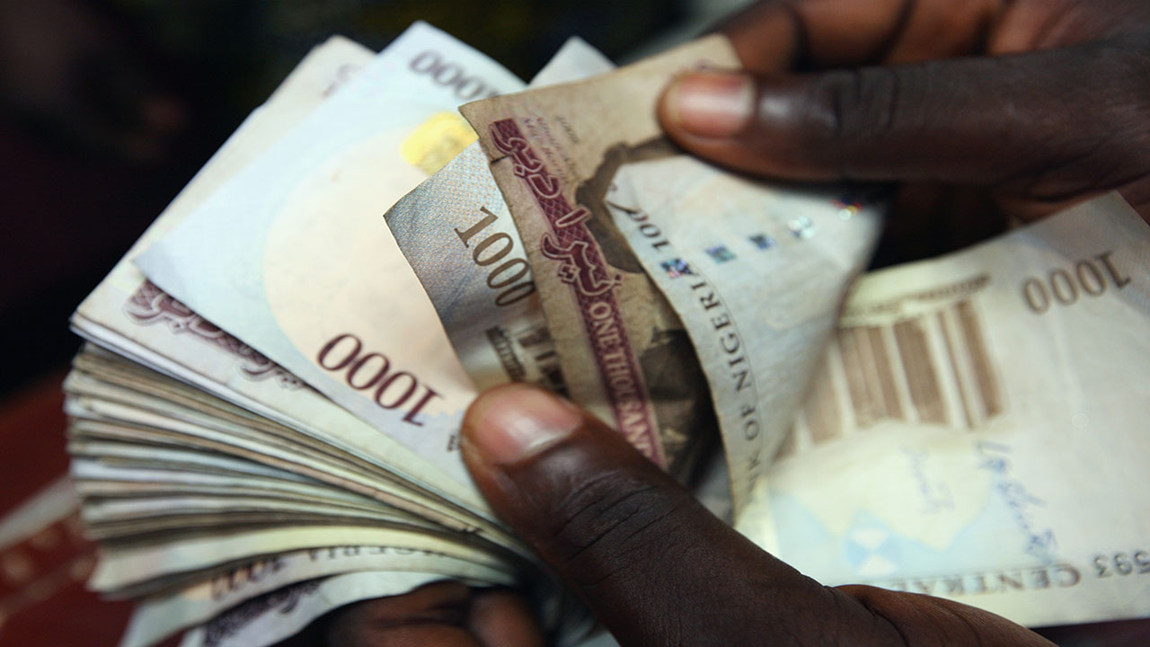 LAGOS, NIGERIA - JULY 15: Nigerian Naira, NGN is counted in an exchange office on July 15, 2008 in Lagos, Nigeria. (Photo by Dan Kitwood/Getty Images)