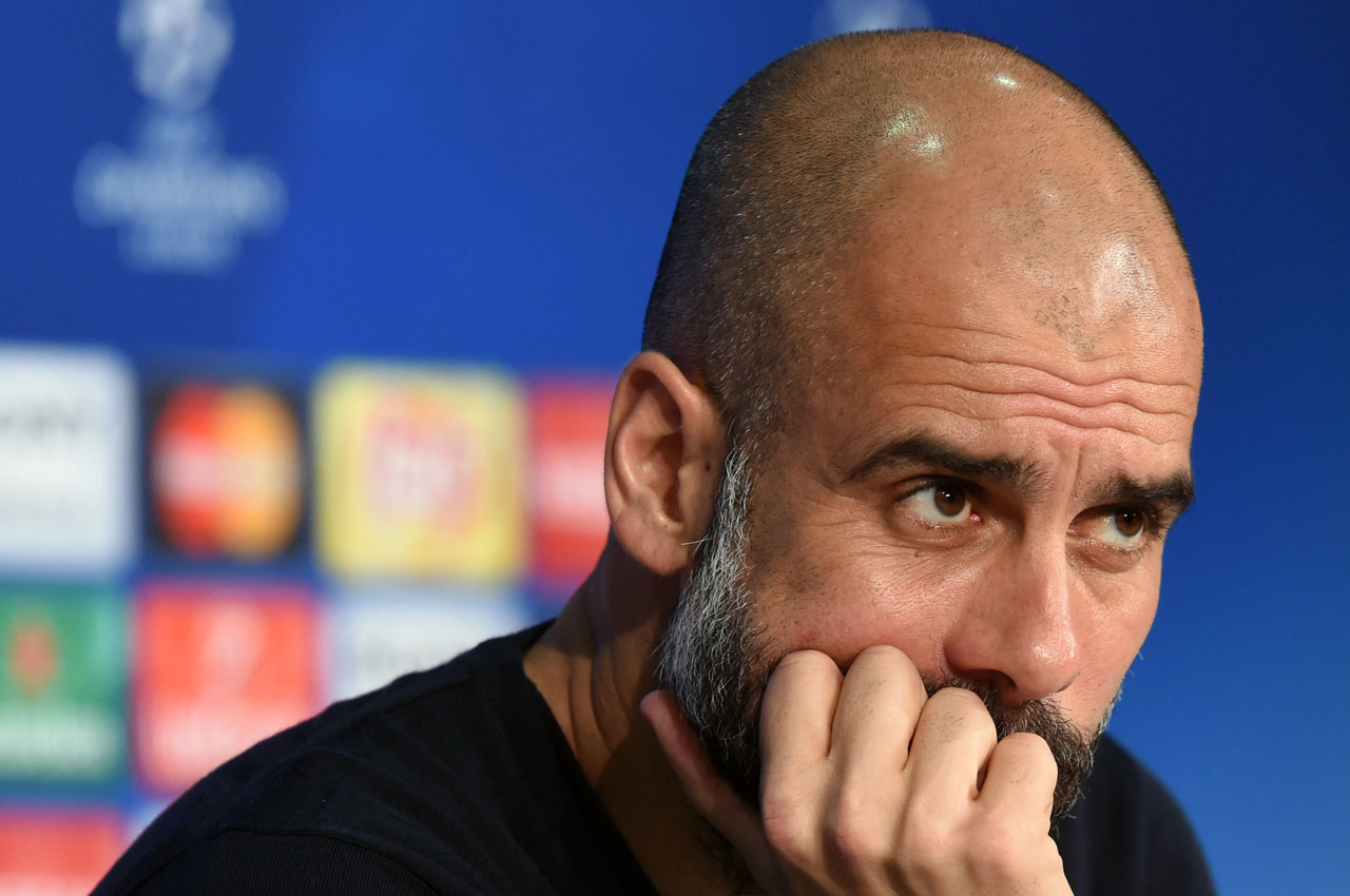 Bayern Munich's Spanish headcoach Pep Guardiola addresses a press conference on the eve ofthe Champions League quarter-final, first-leg football match between Bayern Munich and Benfica Lisbon in Munich, southern Germany, on April 4, 2016. / AFP / CHRISTOF STACHE