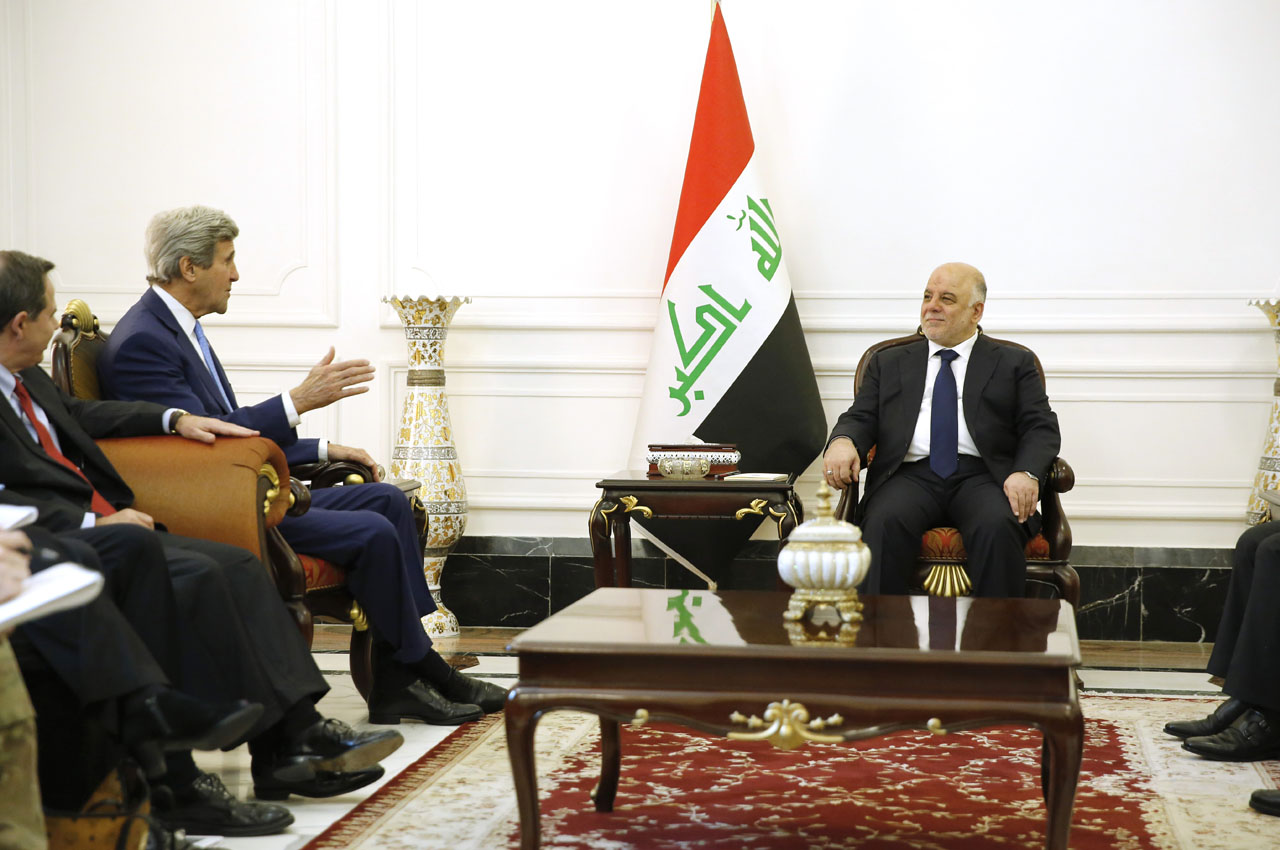 Iraq's Prime Minister Haider al-Abadi (R) listens to US Secretary of State John Kerry at the prime minister's palace in Baghdad on April 8, 2016.  Kerry visited Baghdad to back Iraq's government as it battles jihadists, struggles with a financial crisis and attempts to carry out reforms. / AFP PHOTO / POOL / JONATHAN ERNST