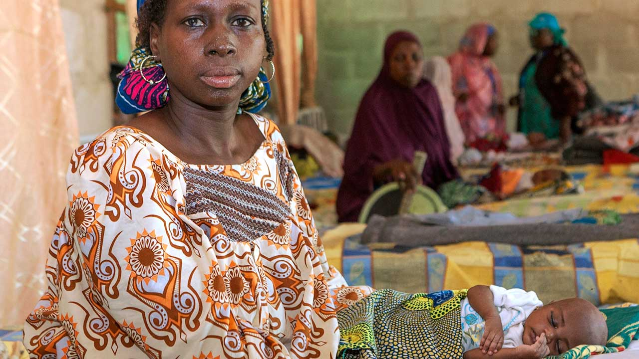 Amina and her baby, Zainab, at the health clinic in Dalori camp for the displaced persons, near Maiduguri