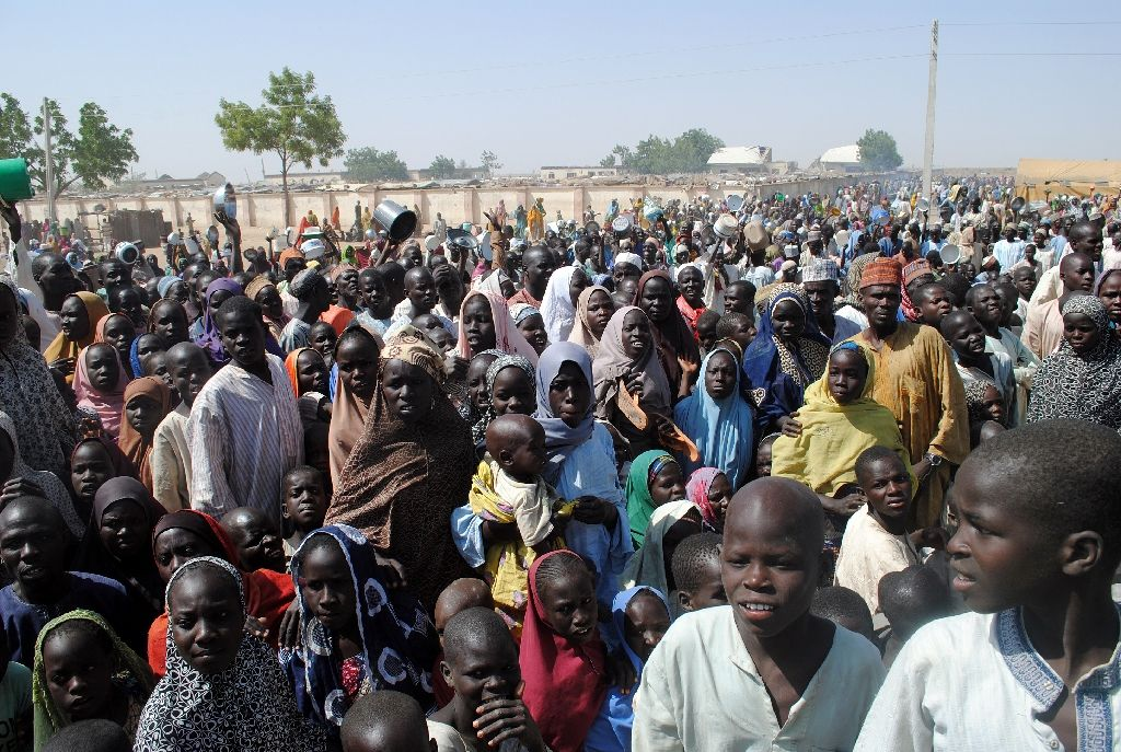 Internally Displaced Persons stand waiting for food at Dikwa Camp, in Borno State in north-eastern Nigeria, on February 2, 2016 Internally Displaced Persons stand waiting for food at Dikwa Camp, in Borno State in north-eastern Nigeria. (AFP Photo/)
