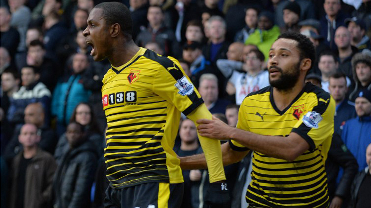 Watford's Nigerian striker Odion Ighalo (L) celebrates with Watford's Scottish midfielder Ikechi Anya AFP PHOTO / OLLY GREENWOOD