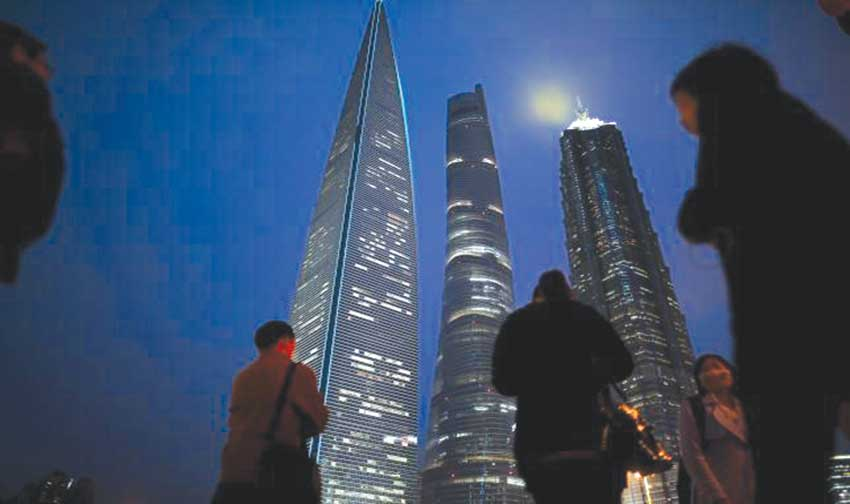People walk on a bridge in the financial district of Pudong in Shanghai, China, yesterday. Photo: REUTERS