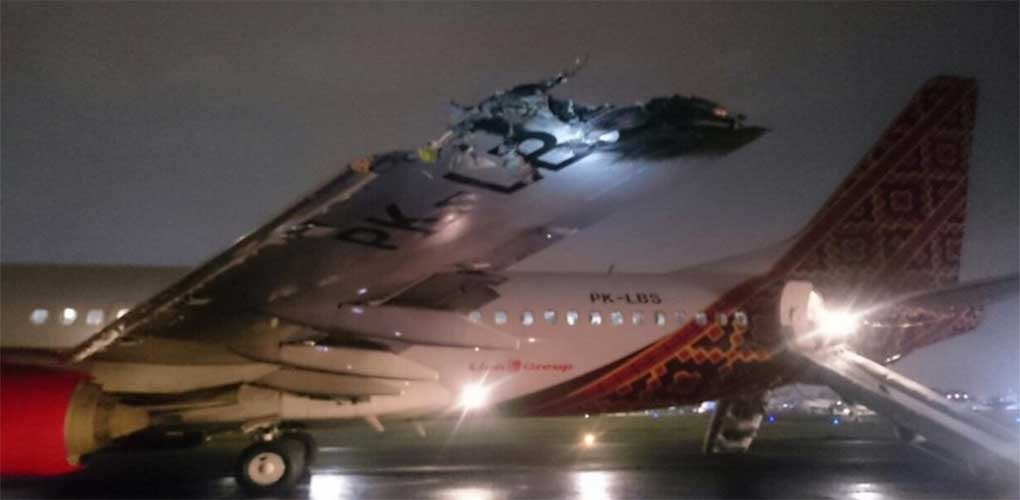 A plane collided with another aircraft while accelerating for takeoff at an airport in Jakarta on Apr. 4, 2016.