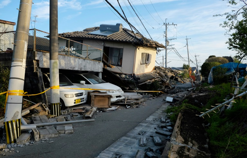 Collapsed houses and damaged cars are seen in Mashiki, Kumamoto prefecture on April 16, 2016 after a powerful earthquake hit southern Japan.