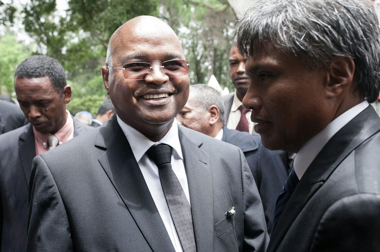 (FILES) This file photo taken on January 17, 2015 shows Madagascar's newly appointed Prime Minister Jean Ravelonarivo (L) attending the handover ceremony at the Mahazoarivo State Palace in Antananarivo. Madagascar's government led by Prime minister Jean Ravelonarivo resigned on April 8, 2016, the presidency announced. / AFP PHOTO / RIJASOLO