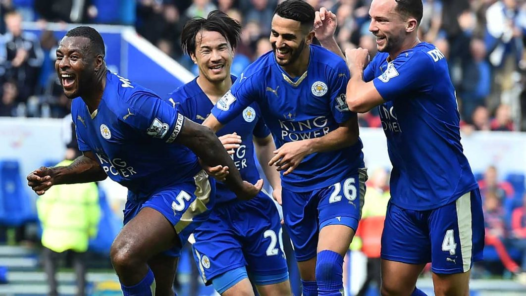 Leicester City's English defender Wes Morgan (L) celebrates after scoring during the English Premier League football match between Leicester City and Southampton at King Power Stadium in Leicester, central England on April 3, 2016. BEN STANSALL / AFP