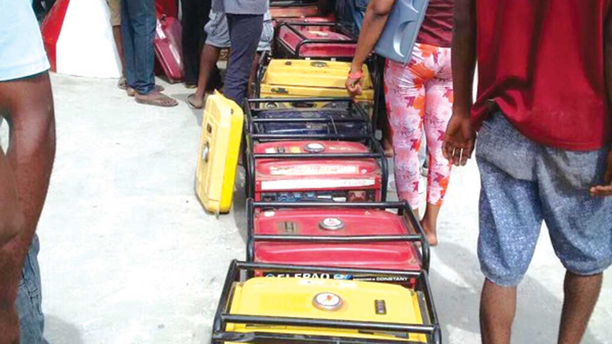 'Operation show your gen'...Buyers standing beside their generators at a filling station  PHOTO: LABA ESEOGHENE