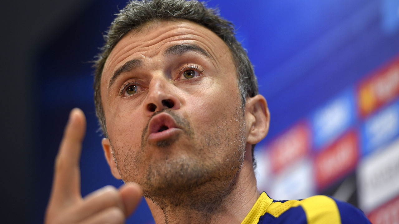Barcelona's coach Luis Enrique  / AFP PHOTO / LLUIS GENE