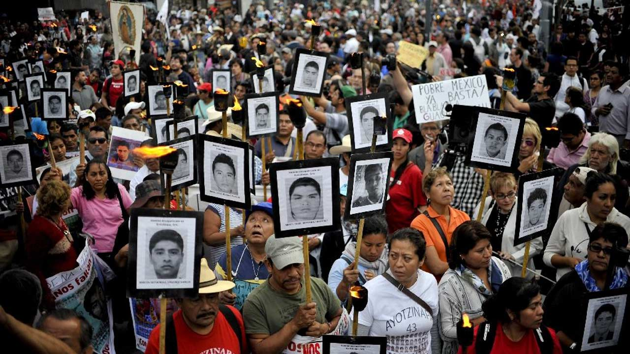 Less than two years ago the parents of 43 missing students would have been surrounded by thousands of people when they marched, but only a few hundred turned out this time in Mexico City (AFP Photo/Yuri Cortez)