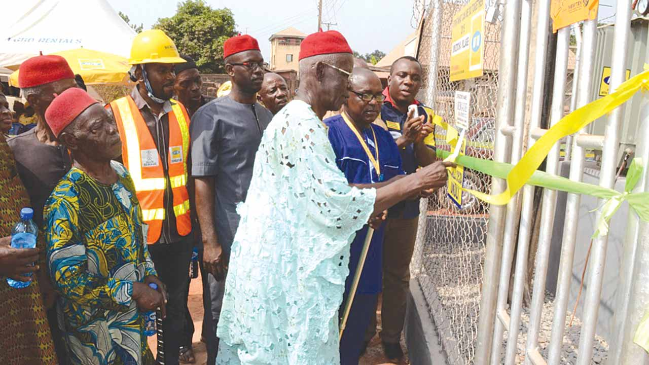 MTNF. Umuzocha: L-R: Umuzocha Community Leader, Chief  Chukwudi Nnajide cutting the tape during the commissioning of a 500KVA Transformer donated by MTN Foundation to the Umuzocha Community in the MTNF What Can We Do Together Campaign.