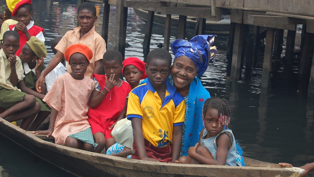 Mama Makoko with children of Makoko slum PHOTO: Women of Rubies