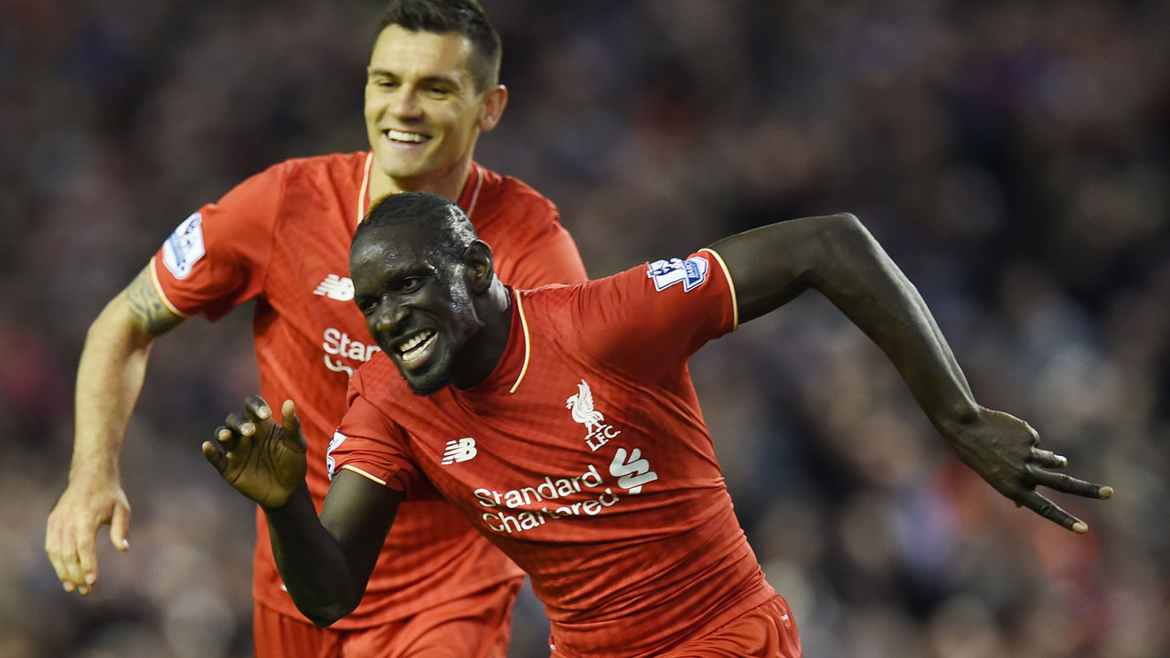 (FILES) This file photo taken on April 20, 2016 shows Liverpool's French defender Mamadou Sakho (R) celebrating with Liverpool's Croatian defender Dejan Lovren after scoring during the English Premier League football match between Liverpool and Everton at Anfield in Liverpool, north west England. Liverpool defender Mamadou Sakho was on Thursday provisionally suspended for 30 days after failing a drugs test, European football's governing body UEFA announced on April 28, 2016. The France international reportedly tested positive for a fat burner after Liverpool's 1-1 draw against Manchester United in the Europa League on March 17. / AFP PHOTO / PAUL ELLIS