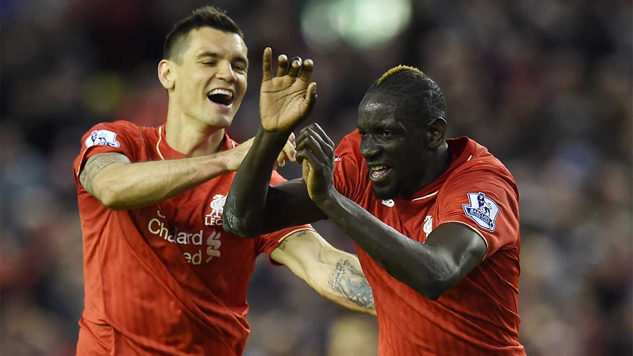 Liverpool's French defender Mamadou Sakho (R) celebrates with Liverpool's Croatian defender Dejan Lovren after scoring during the English Premier League football match between Liverpool and Everton at Anfield in Liverpool, north west England on April 20, 2016.  PAUL ELLIS / AFP