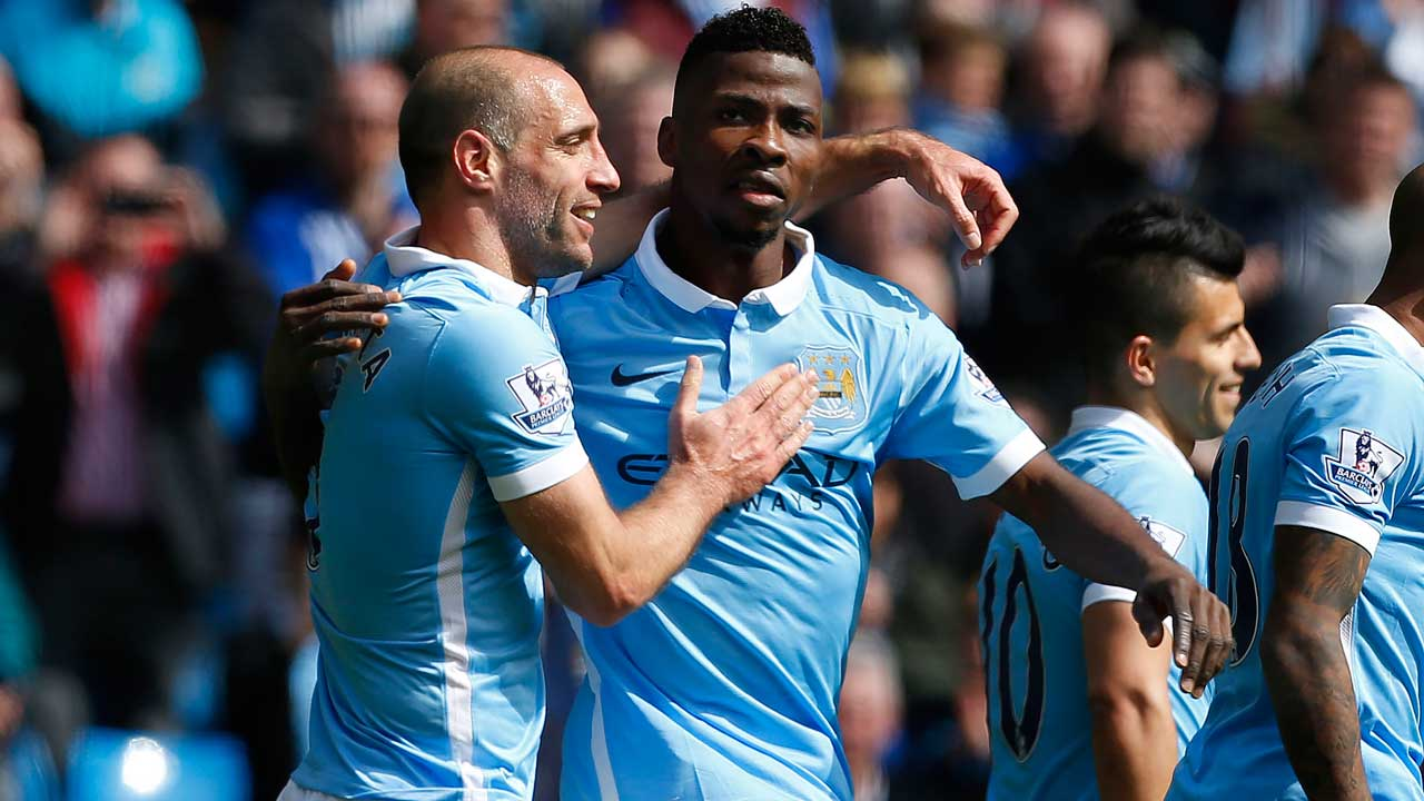Manchester City's Nigerian striker Kelechi Iheanacho celebrates with Manchester City's Argentinian defender Pablo Zabaleta (L) after scoring their third goal during the English Premier League football match between Manchester City and Stoke City at the Etihad Stadium in Manchester, north west England, on April 23, 2016. LINDSEY PARNABY / AFP