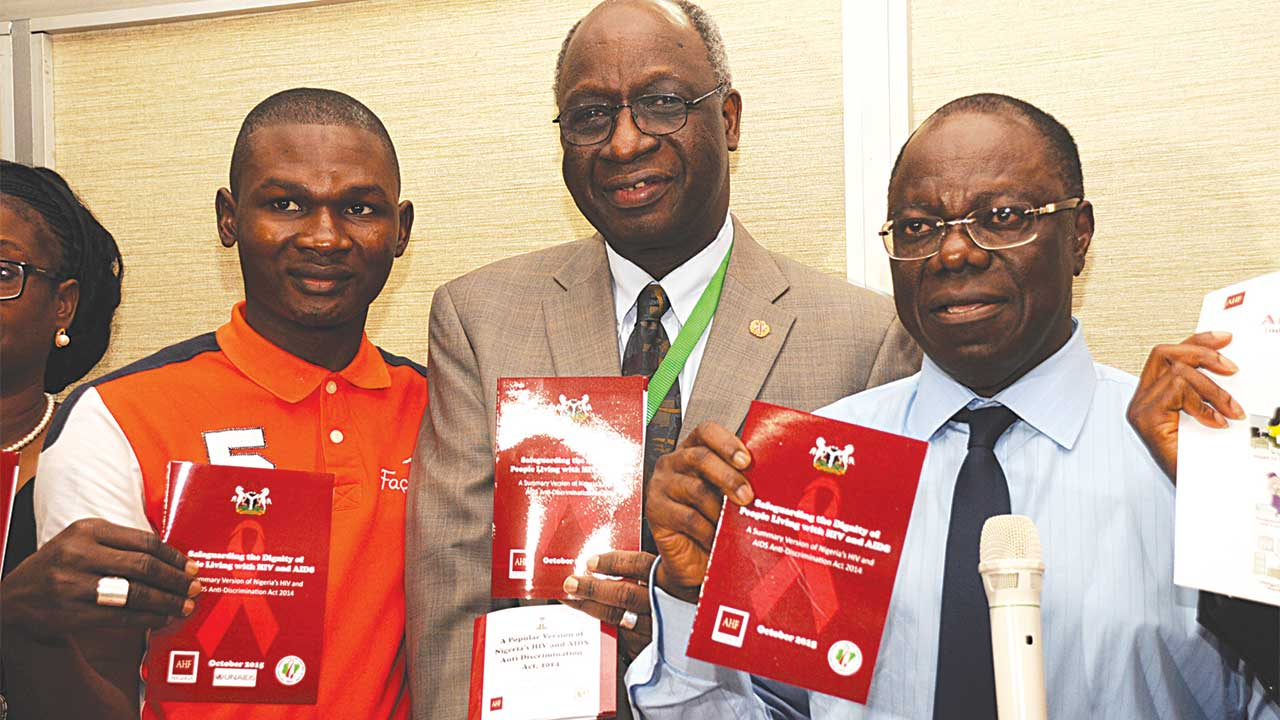 National Secretary of People Living with HIV in Nigeria (PLWHN), Abdukadir Ibrahim; Country Director Joint United Nations Programme on AIDS (UNAIDS), Dr. Bilali Camara; Director General of the National Agency for the Control OF AIDS (NACA) at the unveiling of the popular versions of the Anti Discrimination Law