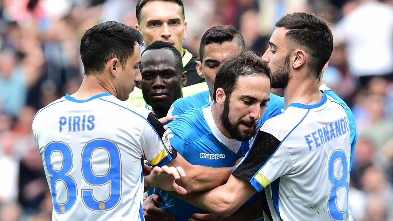 Napoli's forward from Argentina Gonzalo Higuain reacts after he received a red card during the Italian Serie A football match Udinese vs Napoli at Friuli Stadium in Udine on April 3, 2016. GIUSEPPE CACACE / AFP