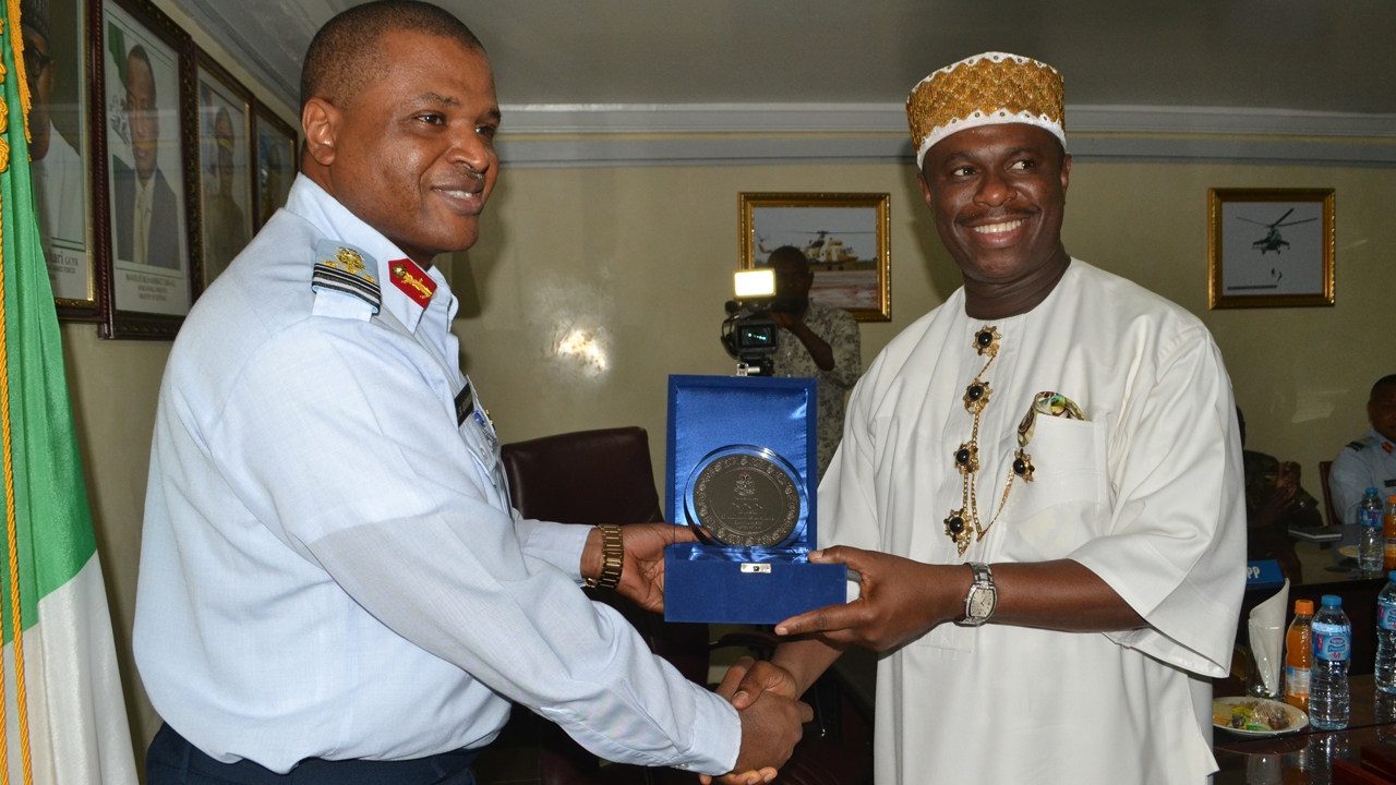 The Director General, Nigerian Maritime Administration and Safety Agency (NIMASA), Dr. Dakuku Peterside, receiving a plaque from the Chief of Air Staff (CAS), Air Marshal Sadique Abubakar during the DG's working visit to Air force Headquarters in Abuja last week