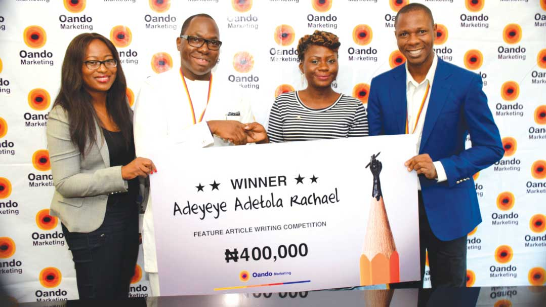 From left: CEO, Oando Downstream Mr. Abayomi Awobokun, (2nd left) presenting the award of N400,000 to Dr. Adeyeye Adetola Racheal, (2nd right) Winner of Oando Marketing Plc 2016 Feature Writing Article themed 'Sustainable Business Solutions to Tackling Climate Change in Developing Countries'; Mrs. Kemi Songonuga (left) Finance Manager, Oando Marketing Plc and Mr. Seun Adeosun (right), Head, Marketing Communications, Oando Marketing Plc.