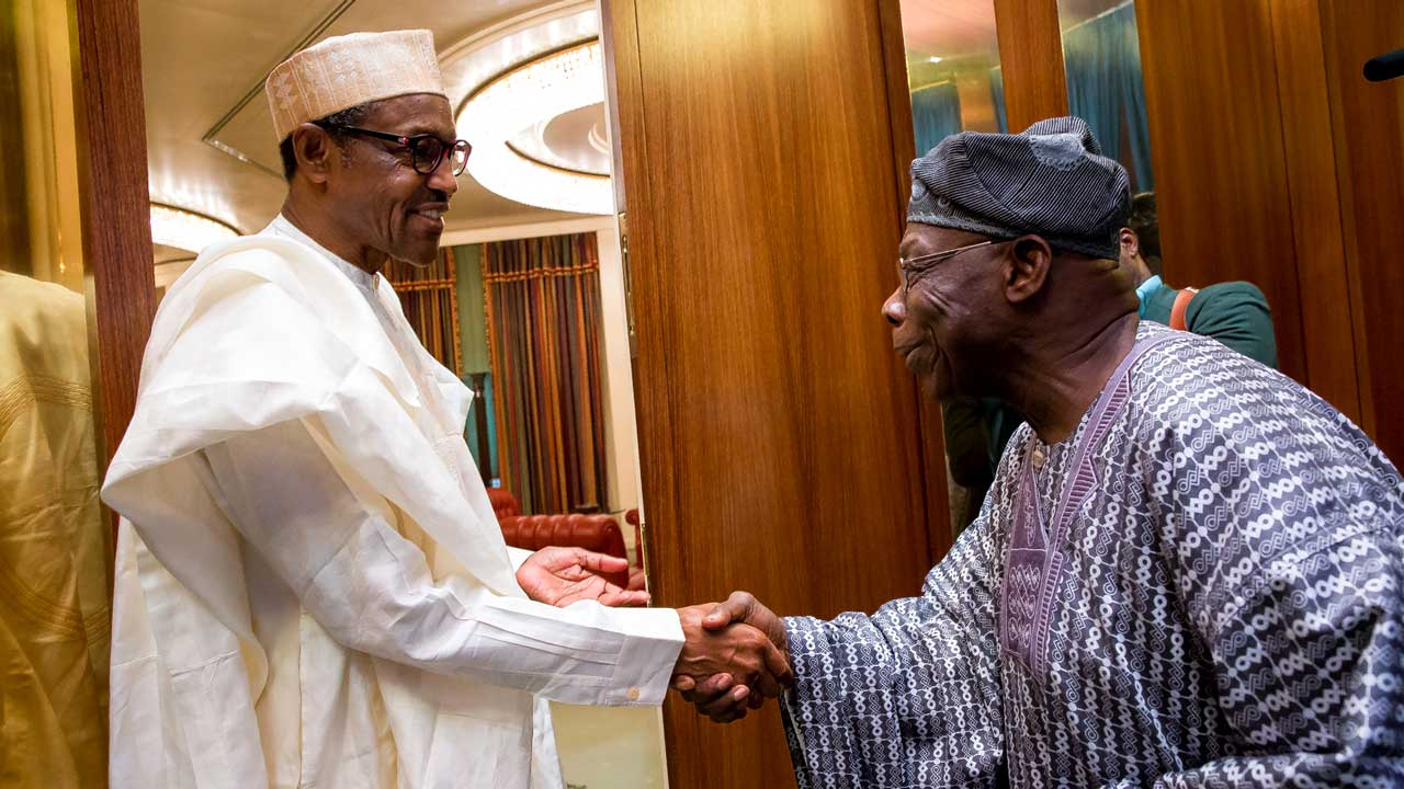 President Muhammadu Buhari left Welcoming Former President Chief Olusegun Obasanjo to his office at the State House Abuja Yesterday from Philip ojisua 7th April 2016 From Philip Ojisua