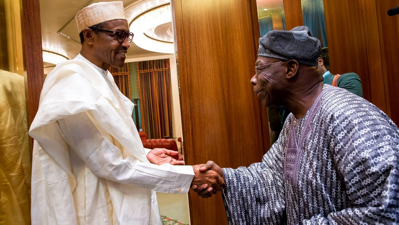 President Muhammadu Buhari  welcoming former President  Olusegun Obasanjo to his office at the State House Abuja on Thursday, 7th April, 2016. PHOTO: Philip Ojisua