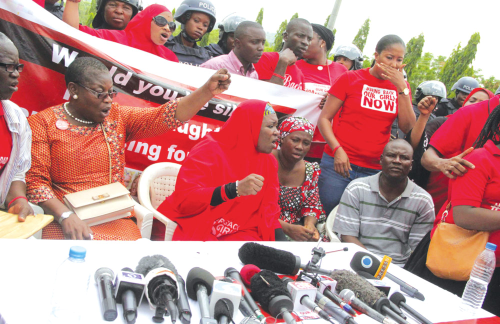 Members of the Bring Back Our Girls Movement at the centre of the road to the Presidential Villa, Abuja as the leader of the group, Oby Ezekwesili addresses the press…yesterday PHOTO: PHILIP OJISUA