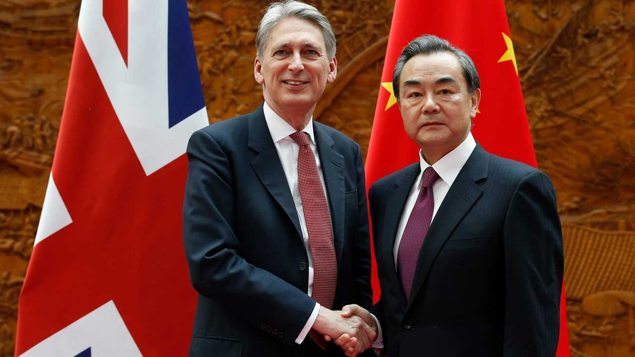 Philip Hammond (left) shakes hands with his Chinese counterpart Wang Yi in Beijing. Photograph: Kim Kyung-Hoon/AFP/Getty Images