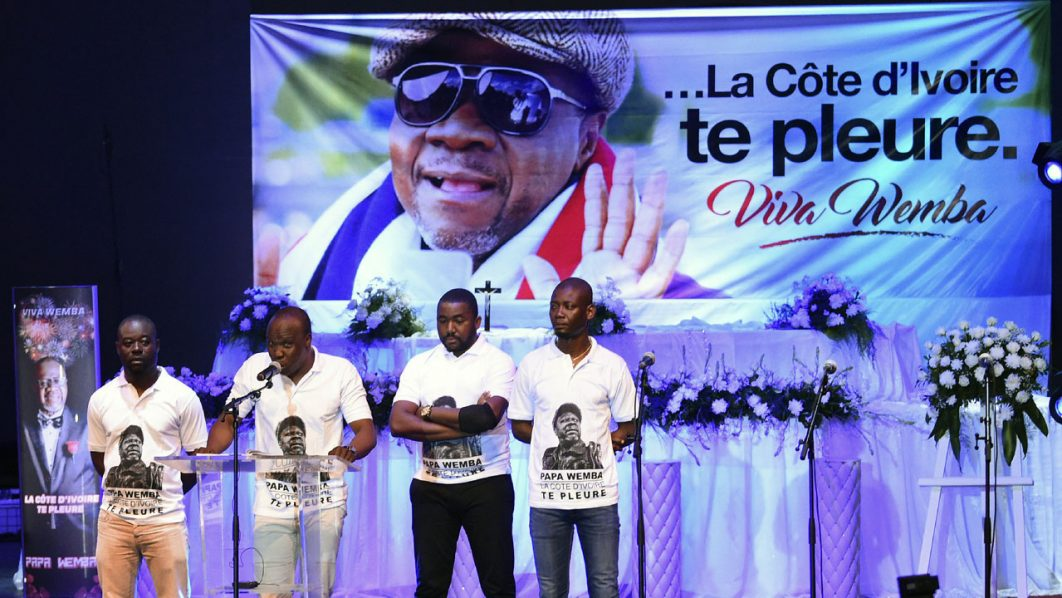 "A'Salfo, the lead vocal singer for the Ivorian group Magic System sings during a concert in tribute to Papa Wemba on April 27, 2016 at the Palace of Culture in Abidjan. The flamboyant star Papa Wemba died at the age of 66 after collapsing on stage at a music festival in Abidjan, Ivory Coast, on April 24, but the cause of death is not yet known. The remains of the ""Congolese king of rumba"" will be flown to his homeland Ivorian musician and festival promoter Salif Traore, known as A'Salfo said. / AFP PHOTO / SIA KAMBOU"