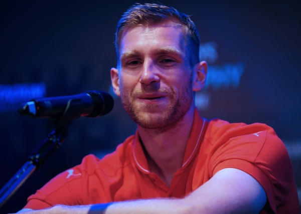 British Premier League football club Arsenal player Per Mertesacker speaks during the press conference for the Barclays Asia Trophy 2015 (BAT) in Singapore. Photo - AFP