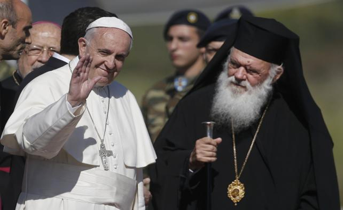 Pope Francis, greeted by Archbishop Ieronimos arrives on the Greek Island of Lesbos for a visit aimed at supporting refugees. PHOTO: uk.reuter.com
