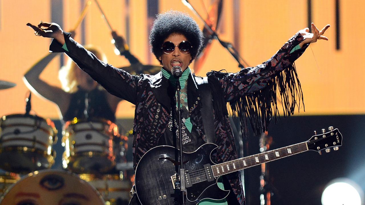 "This file photo taken on May 18, 2013 shows musician Prince performing onstage during the 2013 Billboard Music Awards at the MGM Grand Garden Arena on May 19, 2013 in Las Vegas, Nevada. Pop icon Prince died at his compound in Minnesota on April 21, 2016, a representative said. He was 57. ""It is with profound sadness that I am confirming that the legendary, iconic performer, Prince Rogers Nelson, has died at his Paisley Park residence this morning,"" said his spokeswoman, Yvette Noel-Schure. / AFP PHOTO / GETTY IMAGES NORTH AMERICA / Ethan Miller"